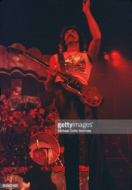Guitarist Tony Iommi of the heavymetal group 'Black Sabbath' plays a Gibson SG electric guitar as he performs onstage in circa 1975