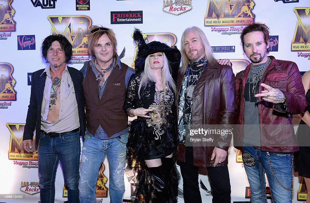 Guitarist Tracii Guns, drummer Rikki Rocket of Devil City Angels and publisher Sally Steele and bassist Eric Brittingham and singer/guitarist Brandon Gibbs of Devil City Angels arrive at The 5th annual Vegas Rocks! Magazine Music Awards at The Pearl Concert Theater at the Palms Casino Resort on November 23, 2014 in Las Vegas, Nevada.