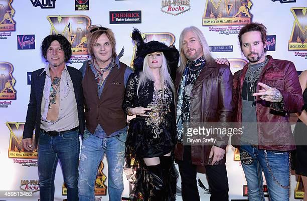Guitarist Tracii Guns drummer Rikki Rocket of Devil City Angels and publisher Sally Steele and bassist Eric Brittingham and singer/guitarist Brandon...