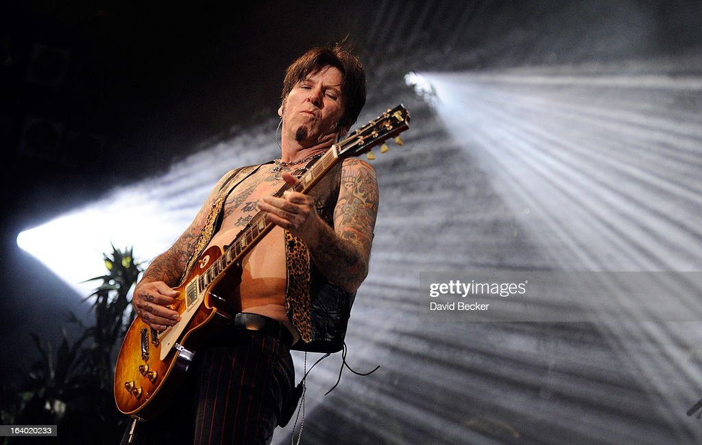 Guitarist Tracii Guns performs in the grand opening of 'Raiding the Rock Vault' at the Las Vegas Hotel & Casino on March 18, 2013 in Las Vegas, Nevada.