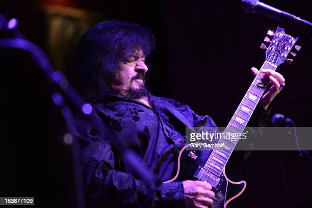 Guitarist Vinny Martell formerly of The Vanilla Fudge performs on stage for the book launch of '108 Rock Star Guitars' benefitting The Les Paul...