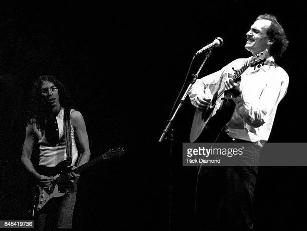 Guitarist Waddy Wachtel and Singer/Songwriter James Taylor perform at The Atlanta Civic Center in Atlanta Georgia May 13, 1981