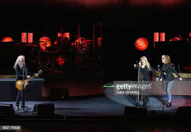 Guitarist Waddy Wachtel singer/songwriter Stevie Nicks and recording artist Chrissie Hynde of The Pretenders perform during the grand opening of Park...