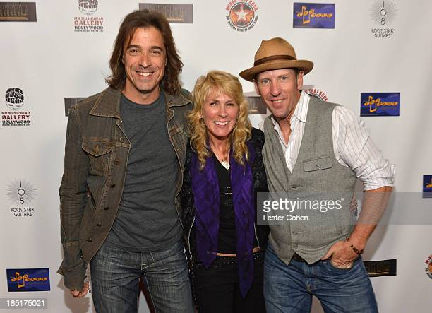 Guitarist Warren DeMartini photographer/author Lisa S Johnson and singer John Thomas Griffith attend '108 Rock Star Guitars' book release at Mr...