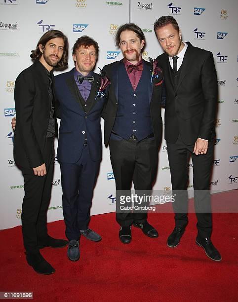 Guitarist Wayne Sermon bassist Ben McKee drummer Daniel Platzman and singer/drummer Dan Reynolds of Imagine Dragons attend the third annual Tyler...
