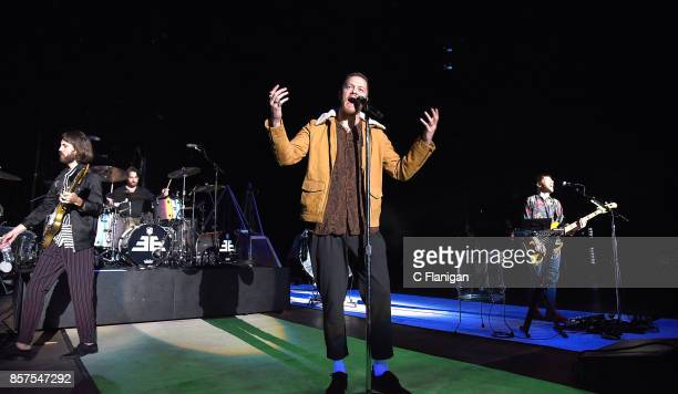Guitarist Wayne Sermon frontman Dan Reynolds and Ben McKee of Imagine Dragons perform during a stop of the band's Evolve World Tour at Shoreline...