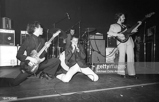 Guitarist Wilko Johnson drummer John 'The Big Figure' Martin singer Lee Brilleaux and bassist John B Sparks of the English RB group Dr Feelgood...