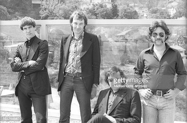 Guitarist Wilko Johnson singer Lee Brilleaux drummer John 'The Big Figure' Martin and bassist John B Sparks of the English RB group Dr Feelgood pose...