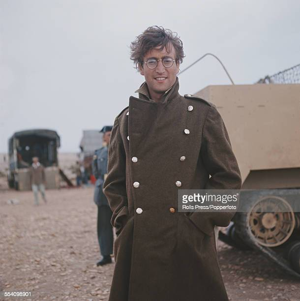 Guitarist with The Beatles John Lennon pictured wearing a military greatcoat and dressed in character as Muskateer Gripweed on location in Almeria...