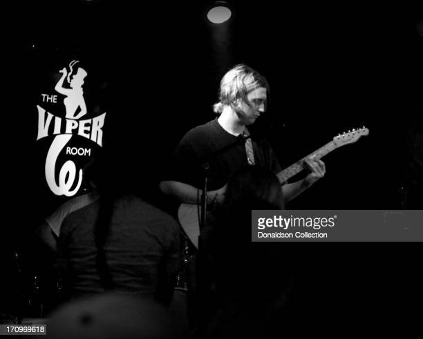 Guitarist Xan Aird of the rock and roll band The Virgins perform onstage at The Viper Room on June 7 2013 in Los Angeles California