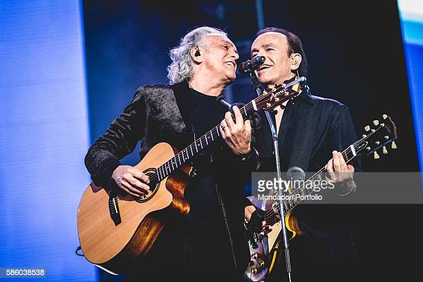 Guitarists and singers Riccardo Fogli and Dodi Battaglia , members of the Italian pop band Pooh, during the concert at the Stadium San Siro, first...