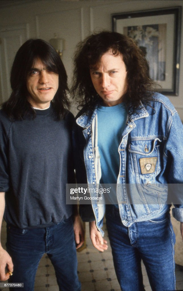 Guitarists Angus Young (left) and his brother Malcolm (1953 - 2017) of Australian rock band AC/DC, Germany, 1992.