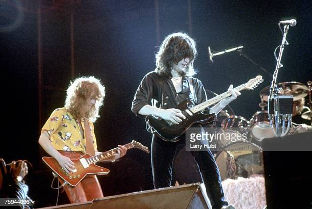 Guitarists Brad Whitford and Joe Perry of the rock and roll band Aerosmith perform onstage in circa 1978