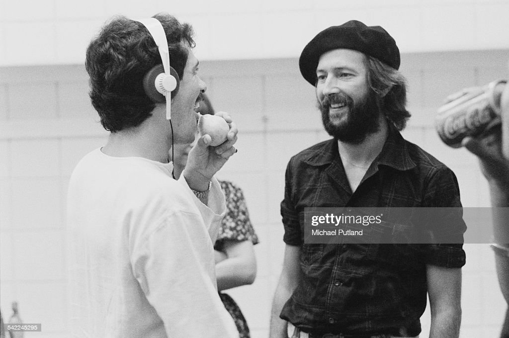 Guitarists Carlos Santana (left) and Eric Clapton backstage during a US tour, 1st July 1975. Santana is Clapton's support act.