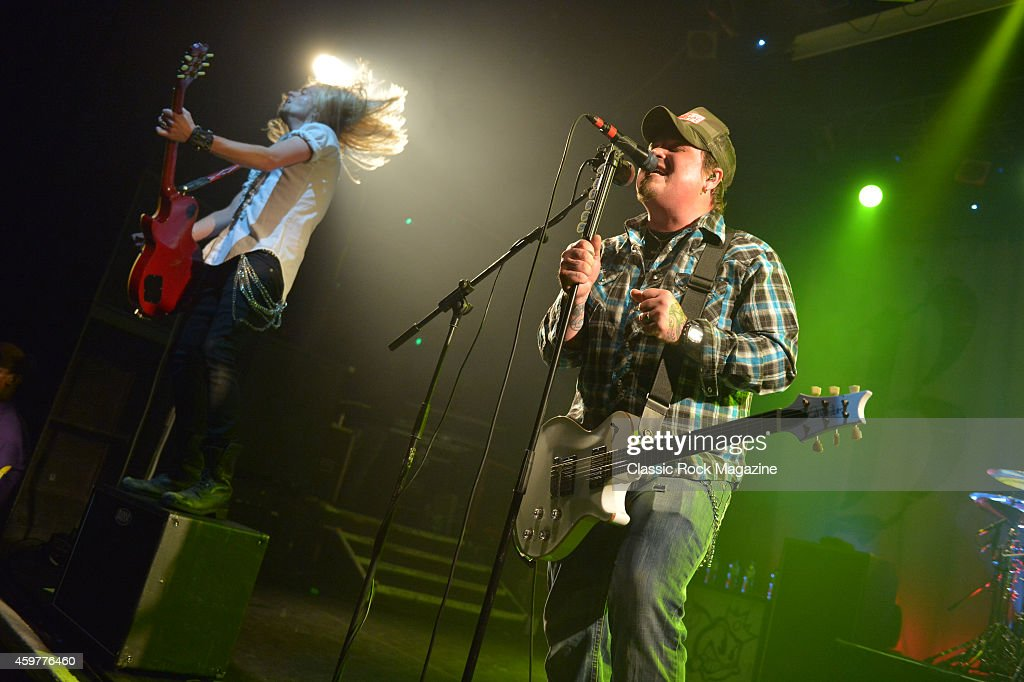 Guitarists Chris Robertson (R) and Ben Wells of American rock group Black Stone Cherry performing live on stage at KOKO in London, on February 28, 2014.