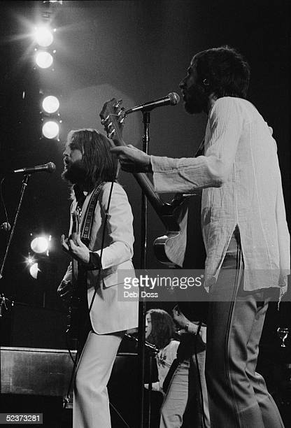 Guitarists Eric Clapton and Pete Townshend performing with Steve Winwood at the keyboards, at Clapton's comeback concert at the Rainbow Theatre,...