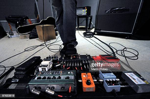 A guitarist's foot operating a rack of guitar effects pedals in a studio on 4th May 2009 in Melbourne Australia