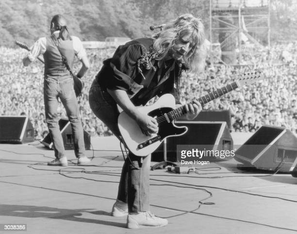 Guitarists Francis Rossi and Rick Parfitt of the rock group Status Quo on stage at Knebworth as the support act for Queen, August 1986.