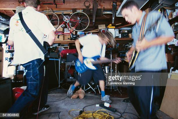 Guitarists in a Garage Band