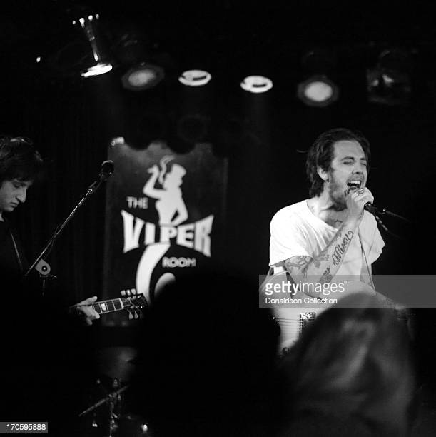 Guitarists Jack Byrne and Malcolm Ford of the rock and roll band The Dough Rollers perform onstage at the Viper Room on June 7 2013 in Los Angeles...