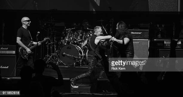'n#893974826 HOUSTON TX DECEMBER 16 Guitarists Joe Satriani Phil Collen and John Petrucci perform in concert with G3 at ACL Live on January 27 2018...