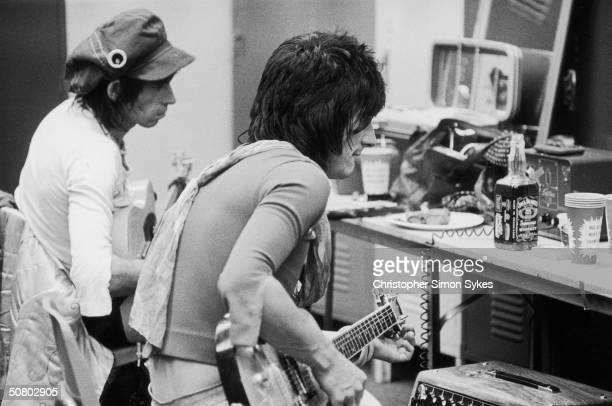 Guitarists Keith Richards and Ron Wood in the tuning room backstage during the Rolling Stones' 1975 Tour of the Americas