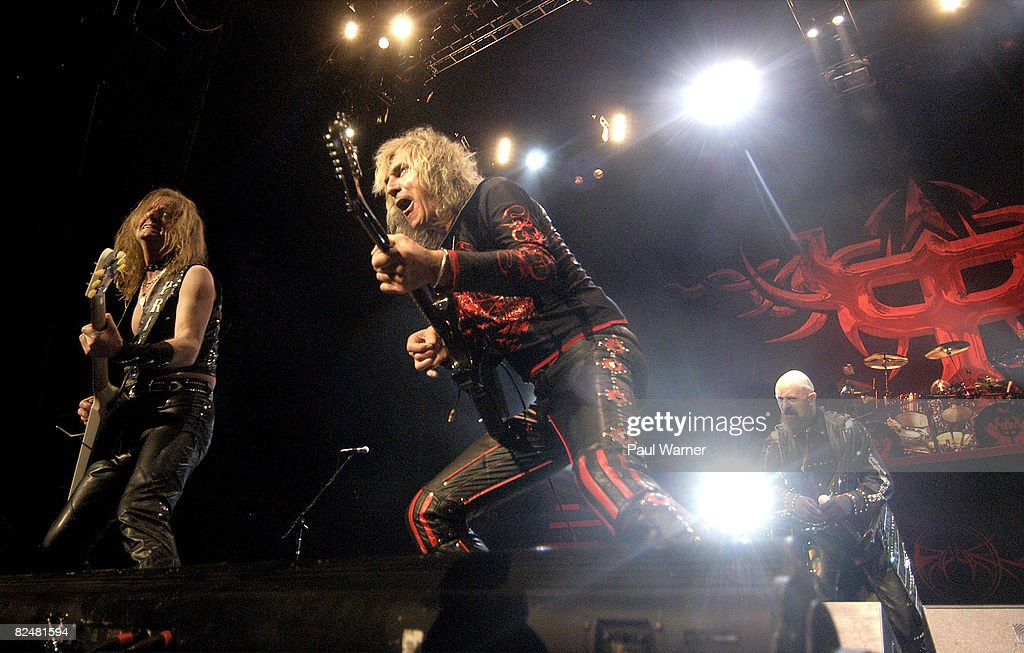 Guitarists K.K.Downing (L), Glenn Tipton (C), singer Rob Halford and drummer Scott Travis of Judas Priest perform during the 2008 Masters of Metal Tour at the First Midwest Bank Amphitheater on August 19, 2008 in Tinley Park, Illinois.