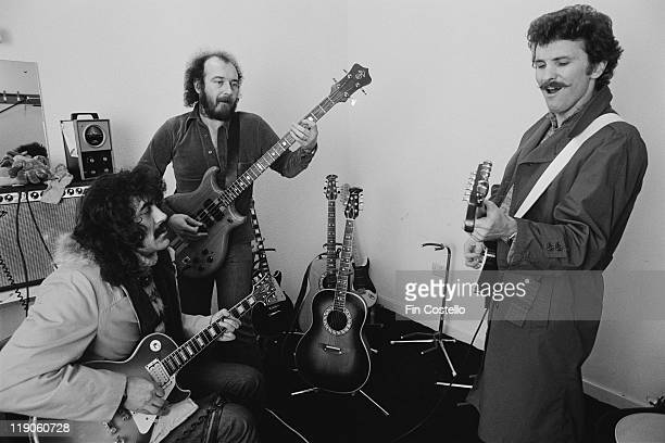 Guitarists Manny Charlton and Zal Cleminson and bassist Pete Agnew of Nazareth rehearsing backstage ahead of a live concert performance by the band...