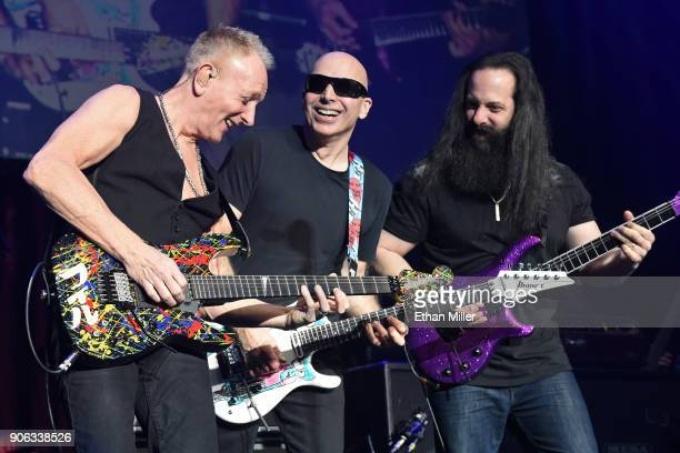 Guitarists Phil Collen Joe Satriani and John Petrucci perform as part of the G3 concert tour at Brooklyn Bowl Las Vegas at The Linq Promenade on...