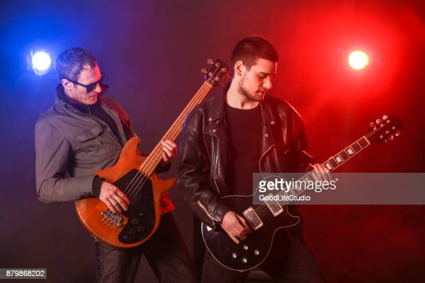 guitarists - classic rock stock pictures, royalty-free photos & images