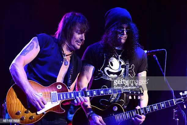 Guitarists Richie Sambora of Bon Jovi and Slash of Guns N' Roses perform on stage at The Roxy Theatre on January 12 2015 in West Hollywood California