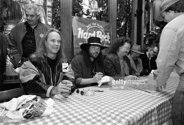 Guitarists Rickey Medlocke and Gary Rossington keyboardist Billy Powell drummer Artimus Pyle of Lynyrd Skynyrd and their sometime producer Al Kooper...