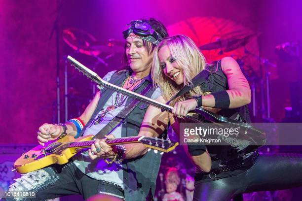 Guitarists Ryan Roxie and Nita Strauss of Alice Cooper perform on stage at Pechanga Casino on August 11, 2018 in Temecula, California.