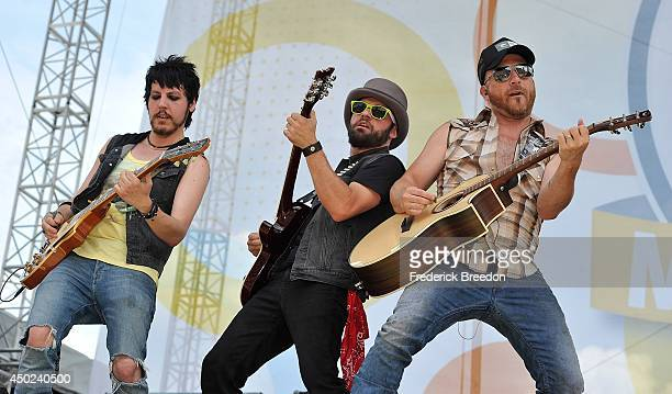 Guitarists Stevens Stokes and Dean Sizemore perform with Preston Brust of the LoCash Cowboys on the Chevy Riverfront Stage at the 2014 CMA Festival...