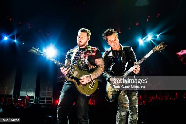 Guitarists Synyster Gates and Zacky Vengeance of American hard rock group Avenged Sevenfold photographed during a live performance at the O2 Arena in...