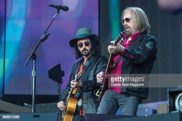 Guitarists Tom Petty and Mike Campbell of American rock group Tom Petty And The Heartbreakers performing live on stage at Hyde Park in London England...