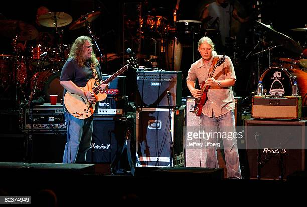 Guitarists Warren Haynes and Derek Trucks of The Allman Brothers Band Band perform at the PNC Bank Arts Center on August 15 2008 in Holmdel New Jersey