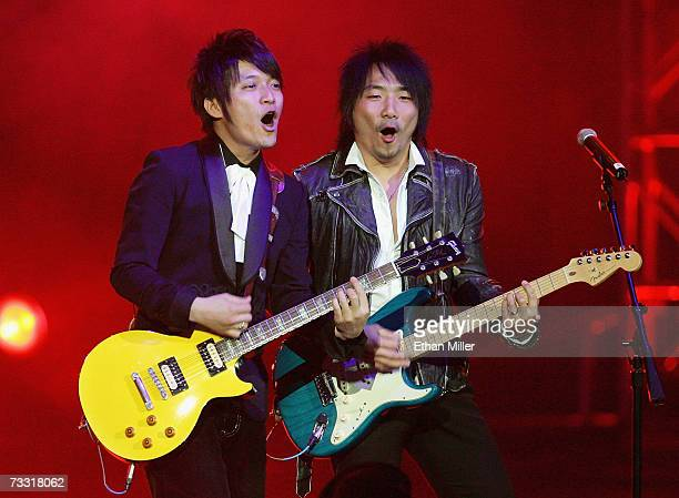 Guitarists Wen Shang Yu and Shi Jin Hang of the Taiwanese rock group Mayday perform during the Fusion 2007 concert at the Aladdin Theatre for the...