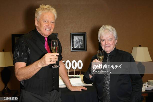Guitarist/singer Graham Russell and singer Russell Hitchcock of Air Supply celebrate backstage with a Champagne toast before the 5000th show of the...