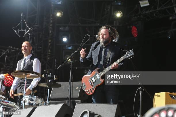 Guitarist/vocalist Malcom Lacrouts and drummer/backing vocalist Phil Jourdain from the French band Inspector Cluzo perform on stage during the...
