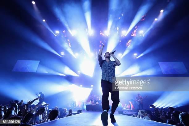 GuitaristWayne Sermon drummer Daniel Platzman frontman Dan Reynolds and bassist Ben McKee of Imagine Dragons perform at Talking Stick Resort Arena...