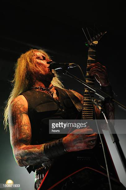 guitarrist and vocalist of metal band at club concert - heavy metal stock photos and pictures