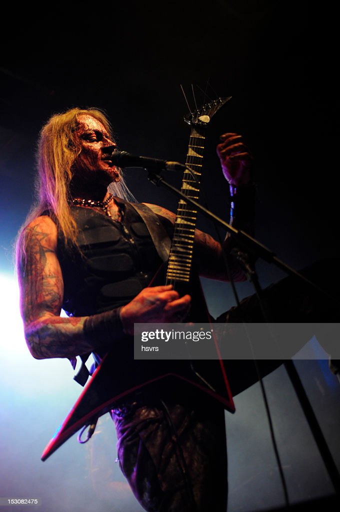 guitarrist and vocalist of metal band at club Concert : Stock Photo
