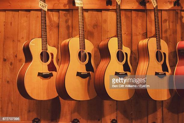 Guitars Hanging Against Wall At Store
