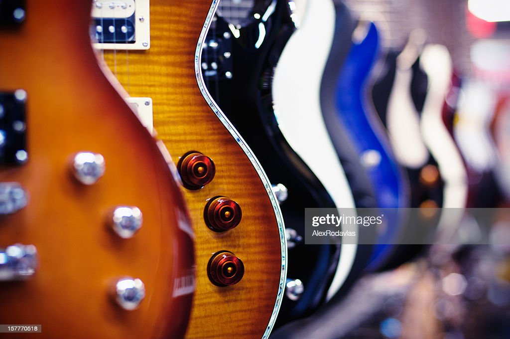Guitars in a shop : Stock Photo