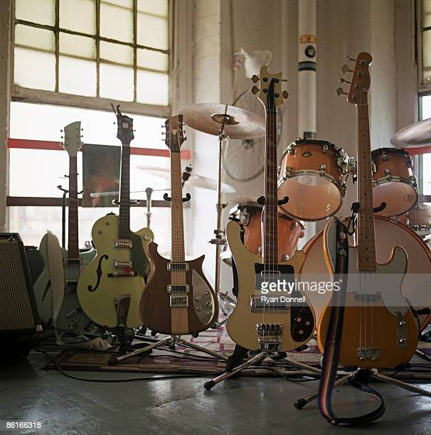 guitars lined up before a concert - modern rock stock pictures, royalty-free photos & images