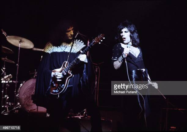 Guitarst Brian May and singer Freddie Mercury of British rock group Queen perform on stage in London 1974