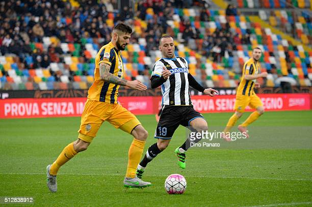 Guitherme dos Santos Torres of Udinese Calcio competes with Eros Pisano of Hellas Verona during the Serie A match between Udinese Calcio and Hellas...