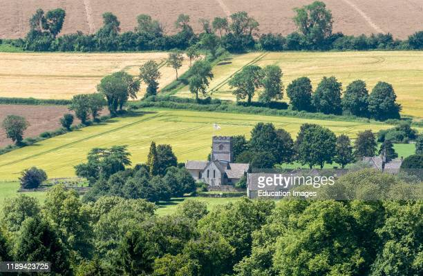 Guiting Power Cheltenham Gloucestershire England An overview of St Michaels and All Angels church at Guiting Power a small village in the Cotswolds...