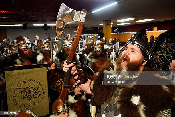 Guizdr Jarl Lyle Gair and members of the Jarl Squad visit the British Legion as they march through the streets of Lerwick on January 31 2017 in the...
